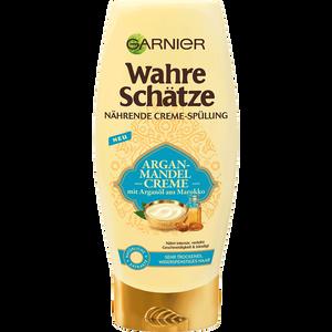 Bild: GARNIER Wahre Schätze nährende Creme-Spülung Argan-Mandel Creme